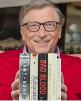 Image of Bill Gates holding books